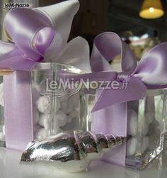http://www.lemienozze.it/operatori-matrimonio/bomboniere/qualcosa_in_piu/media/foto/2  Una conchiglia d'argento come bomboniera per il matrimonio