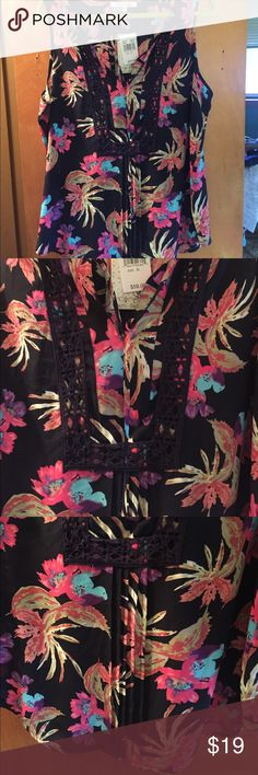 Black Rainn sleeveless top Make a summer statement in this beautiful bright floral top! It's navy blue with pinks, purples and blue. New with tags! black rainn Tops Blouses