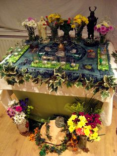 Beltane Altar 2 by ~Druidstone on deviantART. Subtly tie-dyed Celtic altar cloth with a brocade-like motif.