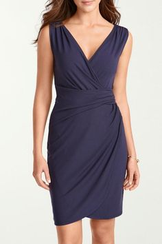 For timeless elegance, look no further than this dress. The travel fabric resists wrinkling, so you'll look as amazing at evening cocktails as you do on the plane. Fashioned to flatter, its bra-friendly surplice bodice gathers at the waist and shoulders. The skirt falls into an asymmetrical faux-wrap front, while a center back seam adds shape. Just add your favorite jewelry and you'll look fabulous everywhere. Machine wash cold inside out on gentle cycle; lay flat to dry. Can also be dry…