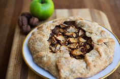 Easy to make savory rustic tart with Granny Smith apples, walnuts, maple syrup, thyme and Gorgonzola cheese