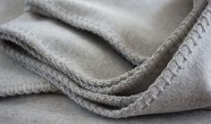 Beautiful grey cashmere with a blanket stitch.