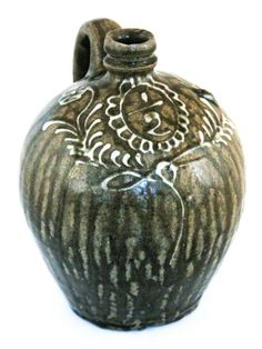 Attributed to Collin Rhodes Factory, Shaw's Creek,  Edgefield District, South Carolina. circa 1850. A  very fine half-gallon jug with an ela...