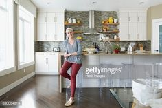 Stock Photo : Portrait of smiling woman in kitchen