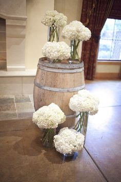 Wine Barrel Wedding Ceremony Altar and white hydrangeas / http://www.himisspuff.com/rustic-country-wine-barrel-wedding-ideas/8/