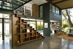 700 Palms Residence modern living room: wood concrete steel glass grey stair storage library lust. way too many good things all in one image.