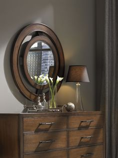 11 South Radius Mirror with Angled Support Brackets that Angle Outward to Gently Project the Framed Mirror into the Room