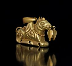 Gold antiquity - ancient Greek gold jewellery: suspension ring and bail were recently attached to make the griffin a wearable pendant; 71.52% average gold content; Hellenistic Gold Griffin circa 3rd-1st Century BCE