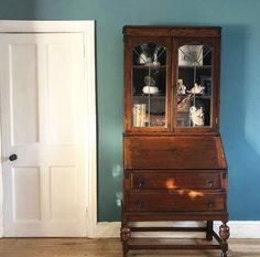 Beautiful solid Oak writing bureau and glass cabinet with gorgeous patina and great storage. Light wear commensurate with age. Small amount of damage on a piece of the glass. Can be moved as two pieces. DM for more details Oak, Storage, Solid Oak, Cabinet, Furniture, Glass Cabinet, Find Furniture, Home Decor, Oak Writing Bureau