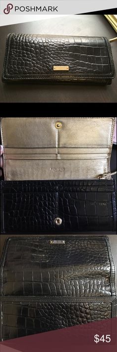 Kate Spade Knightsbridge wallet Kate Spade wallet. Gold on inside is kinda faded. Not sure if it's just from black leather rubbing off on it when you close it. Lining is clean. See all pics. Proceeds from sale go to my dog Chupy's trip in June or July (depending on how quickly I can raise money to go). He's a senior rescue that I'm taking to live loud before he gets too old to travel. He's had a ruff life so now I'll be taking him to tube down the Guadalupe River in Texas and to the beach…