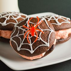 Spiderweb Whoopie Pies Recipe Desserts with fudge cake mix, large eggs, canola oil, water, unsalted butter, confectioners sugar, Marshmallow Fluff, cream cheese, orange extract, gel food colouring, confectioners sugar, milk