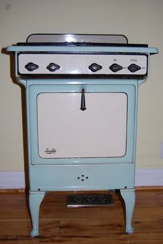 Vintage Enameled Gas Oven Stove in Mint Green and Creamy Yellow. $225.00, via Etsy.