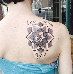 Intricate, lovely mother and child silhouette tattoo surrounded by a lovely dotwork lotus/mandala and children's names. http://thestir.cafemom.com/beauty_style/157931/brilliant_tattoo_ideas_for_moms