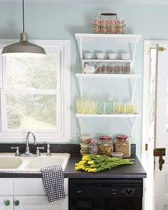 Hang bracketed shelves in a tight space — they'll keep you organized without the bulk of cabinets, and are the perfect place to display cute glassware.