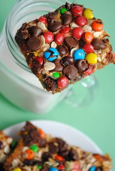 Monster Magic Cookie Bars- 9 full graham crackers,4 tbsp. butter, 1 can sweetened condensed milk, approximately 3/4 c. oats, approximately 3/4 c. M, approximately 3/4 c. chocolate chips