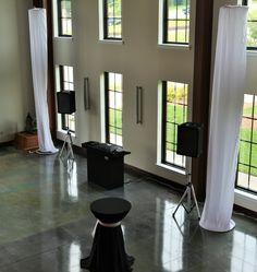 DJ Stand and Speakers with Cocktail Tables