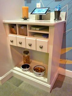 A pet center & charging station for the kitchen. Have cabinet space for pet food, medicines, brushes, etc., plus food and water bowls. Plus an outlet to charge the iPad!