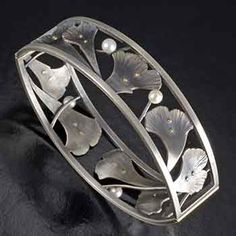 """Jude Clarke. Bridges. Bracelet in sterling silver with 14k & 18k gold, and pearls. 3 x 3/4 x 2 1/2""""."""