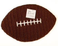"""This crochet football cork board is perfect for tacking up sports schedules or showing off special keepsakes ... perfect for your child's bedroom or your """"sports cave"""" ... FREE crochet pattern and tutorial."""