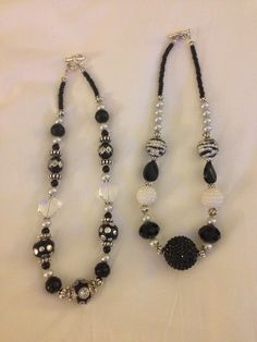 Black & white beaded necklace designs www.facebook.com/BEYONDLINKSANDBEADS