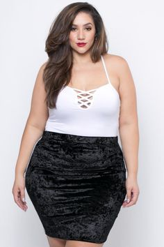 This plus size, knit skirt features an elasticized wiast, andan allover lush crushed velvet fabric, and a side stripe for an added style. Made in USA Content