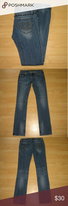 """REROCK 4 Express Straight Leg Studded Jeans These jeans are preloved but still in very good condition. They are a straight leg style jean with studs around the waistband and outer thigh seams. Made of 98% cotton 2% spandex. Tag size is   2.  Waist across with natural dip is 14"""" Waist across when aligned is 14.5"""" Front Rise is 6.75"""" Inseam is 32.5"""" Express Jeans Straight Leg"""