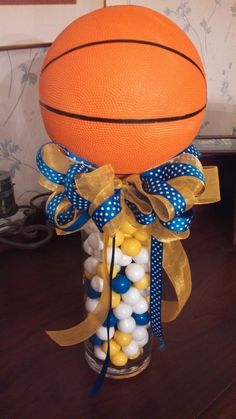 Center pieces using gum balls for Basketball banquet---cute for any type of sport--or even put flowers on top...