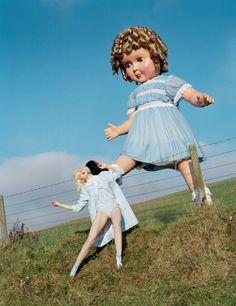 Giant doll kicks Lindsey Wixson, Eglingham Hall, Northumberland, 2011. By Tim Walker