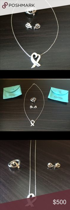 Authentic Tiffany & Co. Set necklace/earrings/ring Authentic Tiffany & Co. Paloma Picasso Loving Heart sterling silver set (earrings, necklace @ ring size 5) Great condition!•Retail price $650•Earrings back are not authentic but are 925 silver•Comes in genuine pouch and box•••If interested buying separate ask for the price•MAKE AN OFFER•Can do $300 on Ⓜ️ Tiffany & Co. Jewelry