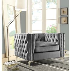 This Chair and a Half will give your home the renaissance it deserves. Comfort and style are evident in this dynamic chair. This chair features rich-hued button tufted velvet with contrasting silver nail head trim accenting clean square arms, high-density foam padding, removable cushions and sturdy Y-shaped coordinating silver chrome metal legs.
