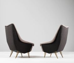 Set of Two Italian Lounge Chairs by ISA, 1950s   From a unique collection of antique and modern lounge chairs at https://www.1stdibs.com/furniture/seating/lounge-chairs/
