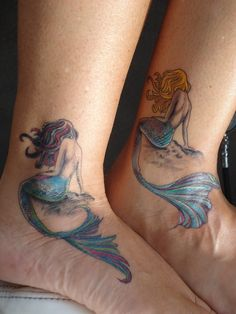 I love the mermaid on the left  never thought of a mermaid for a tattoo but this is perfect !