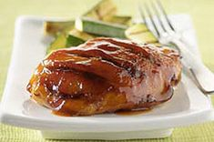 Honey lends sweetness while the pepper sauce adds heat to the bottled barbecue sauce slathered over succulent chicken pieces during grilling.