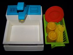 Fisher Price Toys  vintage 1982 Kitchen Sink set...soooo had this and my mom would fill it up with water and I loved it!!