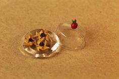 Lautanen=nappi, Kupu= (strepsils)tabletin läpipainomuovi
