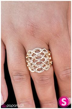 On the Airwaves - Gold: Wavy bands of gold intertwine with sparkling rows of warm rhinestones, creating tiny figure eights.  Sold as one individual ring.