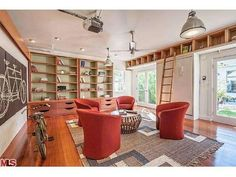 love the built in bookshelves as well as the ladder to the high shelf
