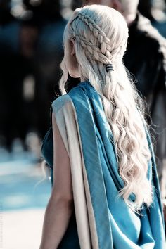 Khaleesi's four braids merge and flow into loose curls as she leads the army of the Unsullied.   - HarpersBAZAAR.com