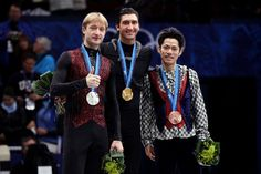 Daisuke Takahashi Photos Photos - Gold medalist Evan Lysacek (C) of the United States poses with silver medalist Evgeni Plushenko (L) of Russia and bronze medalist Daisuke Takahashi of Japan in the men's figure skating free skating on day 7 of the Vancouver 2010 Winter Olympics at the Pacific Coliseum on February 18, 2010 in Vancouver, Canada. - Figure Skating - Day 7