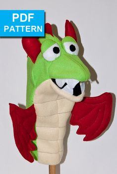"Dual Color Dragon Hand Puppet with Moving Mouth by TheTucsonPuppetLady.  This dragon looks almost like the ""real"" dragons found in storybooks.   The only materials required are fleece, foam and felt.  With our detailed instructions and video tutorials someone with basic sewing skills can make it in an afternoon. Pattern available only at https://www.etsy.com/shop/TheTucsonPuppetLady www.TheTucsonPuppetLady.com"