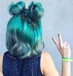 Two top buns with wonderful turquoise hair color, this style is fabulous.