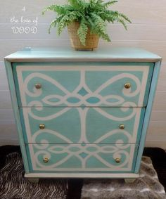 designer makeover with turquoise and white paint of a simple dresser