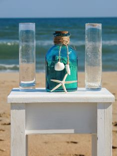 beach wedding sand ceremony This is such a great idea instead of the unity candle.  We are planning on having 7 different shades of neutral color sand so our kids can be apart of the unity of family.  Beautiful!