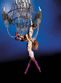 Cirque du Soleil  two performers using a chandelier to dance on. Unconventional spaces for each performance is one of the key elements of a Cirque performance.