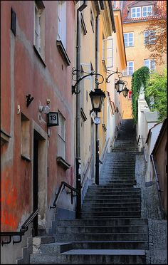 Stairs with lamp, Warsaw, Poland I swear these are the steps we walked down when I was a little girl visiting my grandpa Warsaw Old Town, Warsaw Poland, Places Around The World, Travel Around The World, Around The Worlds, Places To Travel, Places To See, Poland Travel, Italy Travel
