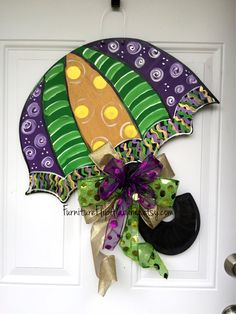 Festive Door decor for the Mardi Gras. Sure to add character to your door. Comes with bow.  hand made hand cut sealed for protection 0.5 plywood light weight painted on back measures about 24tall and 20 Wide  customizable you can choose the wording you want Happy Mardi Gras your Last name  BOW IS INCLUDED - when you order specify in the notes to seller if you want wording