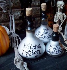 Potion bottle decorations made with burned out lightbulbs and recycled wine corks.