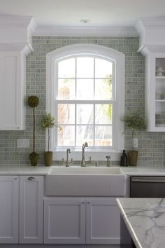 light white kitchen. Feels so serene. Colors, tile, topiaries