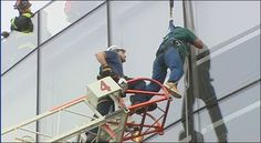 Firefighters rescued a terrified window washer Thursday after he slipped from his seat and was left dangling 60 feet above the ground at Seattle Center's McCaw Hall. The man was cleaning windows outside the buildings' top floor Thursday just before noon when some kind of malfunction caused him to fall from his seat.