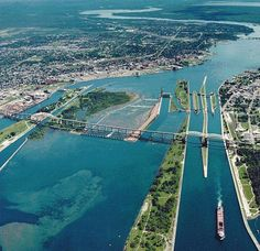 The Soo Locks at Sault-Ste-Marie. They connect Lake Superior with the Lower Lakes, bypassing the rapids of the St. Lake Michigan, Michigan Travel, State Of Michigan, Detroit Michigan, Northern Michigan, Wisconsin, Places To Travel, Places To See, Grands Lacs